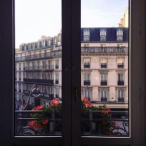 Paris hotel window with hotel concierge