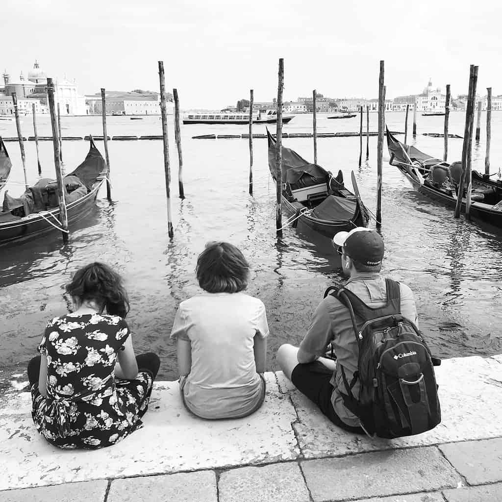 Resting on Venice Waterfront next to Gondolas Europe Travel