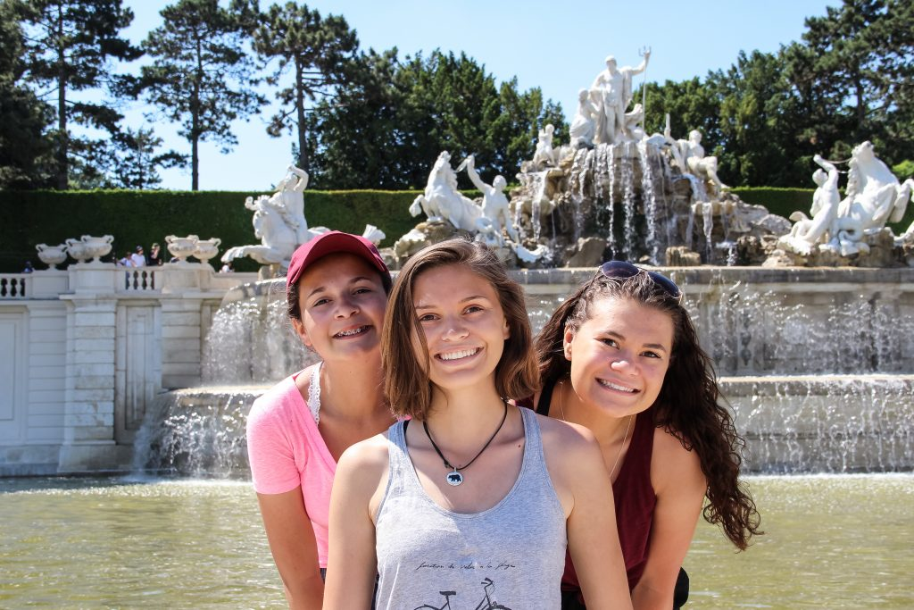 Three girls next to fountain in the gardens of the Schonbrunn Palace