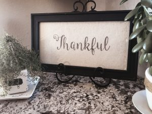 Thankful vignette with plants and frame