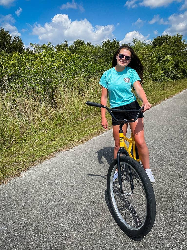 Young girl biking in Shark Valley