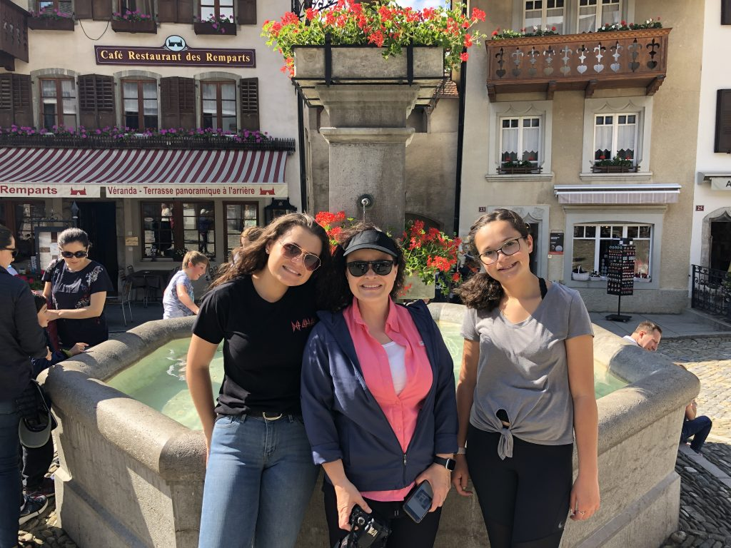 A mom with her daughters in Colmar, France